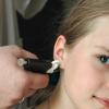 Чи боляче проколювати вуха?